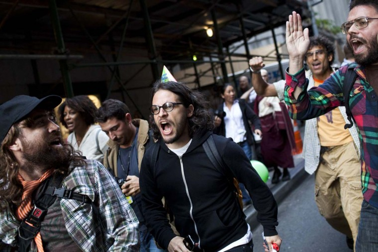 Occupy Wall Street protesters protest through the streets of New York's Financial District during the one-year anniversary of the Occupy Wall Street movement in New York. (REUTERS/Andrew Burton)