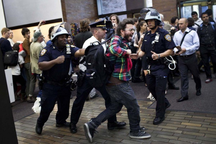 An Occupy Wall Street protester is arrested after holding a demonstration inside the lobby of a JP Morgan building during the one-year anniversary of the Occupy Wall Street movement in New York's Financial District. (REUTERS/Andrew Burton)