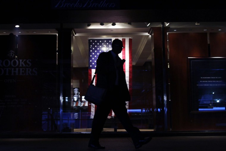 A man walks by a flag near the World Trade Center site before ceremonies marking the 11th anniversary of the September 11, 2001 attacks on the World Trade Center at Ground Zero in New York September 11, 2012. (Shannon Stapleton/Reuters)