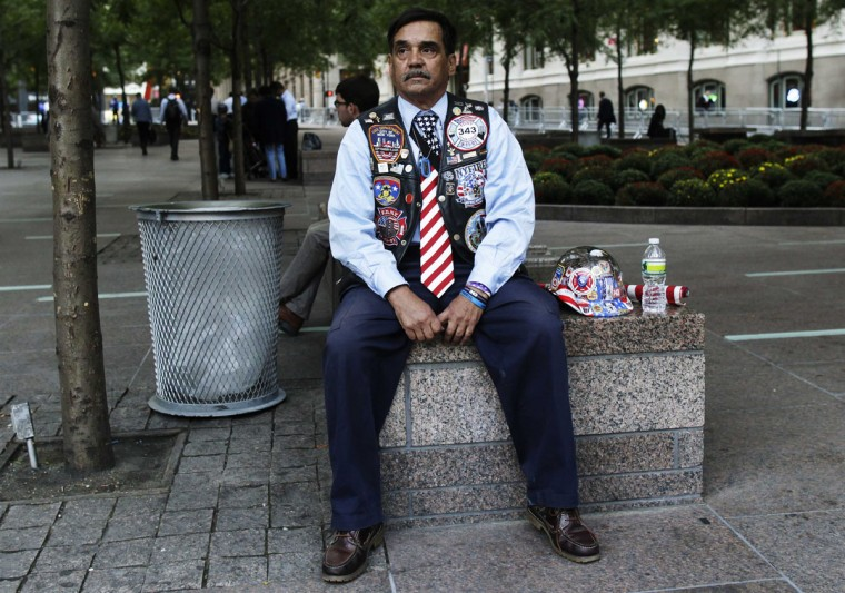 Jose Gonzales sits in Zuccotti Park before ceremonies marking the 11th anniversary of the September 11, 2001 attacks on the World Trade Center at Ground Zero in New York September 11, 2012. (Shannon Stapleton/Reuters)