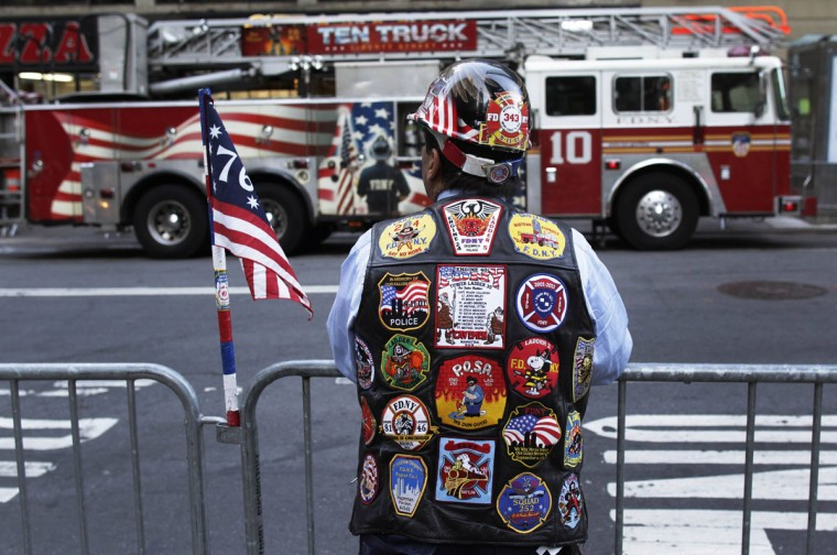 A man stands along Trinity Place before ceremonies marking the 11th anniversary of the September 11, 2001 attacks on the World Trade Center at Ground Zero in New York September 11, 2012. (Shannon Stapleton/Reuters)