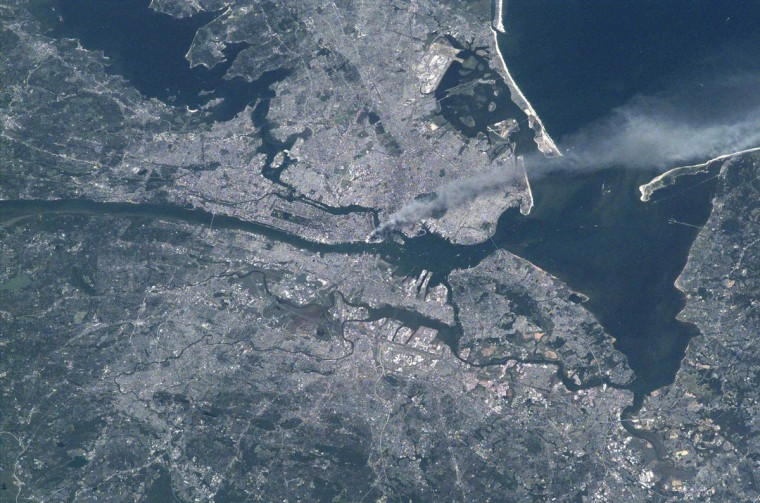 Visible from space, a smoke plume rises from the Manhattan area after two planes crashed into the towers of the World Trade Center on Sept. 11, 2001. (NASA)