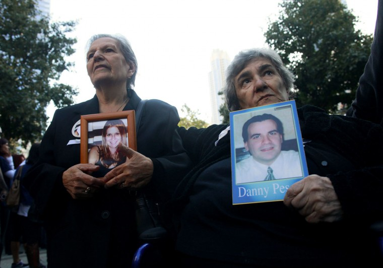 Lucrezia Susca (L) holds a photo of her daughter Grace Gollante-Susca and Chiara Pesce holds a photo of her son Danny Pesce during ceremonies marking the 11th anniversary of the 9/11 attacks on the World Trade Center, in New York, September 11, 2012. (Eric Thayer/Reuters)