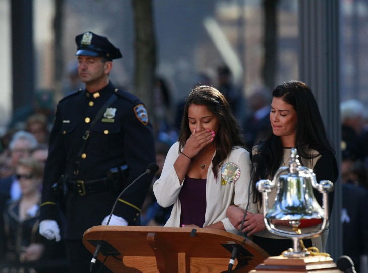 A reader breaks down in tears while reading victims' names during ceremonies marking the 11th anniversary of the September 11 attacks on the World Trade Center, in New York, September 11, 2012. (Eric Thayer/Reuters)