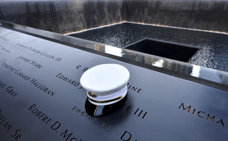 A firefighter's hat sits on names of firefighters who perished, at the South Pool during ceremonies marking the 11th anniversary of the 9/11 attacks on the World Trade Center in New York, September 11, 2012. (Justin Lane/Reuters)