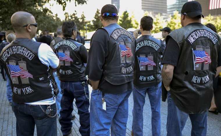 Members of the American Brothers New York Motorcycle Club pause at the South Tower during ceremonies marking the 11th anniversary of the 9/11 attacks on the World Trade Center in New York, September 11, 2012. (Timothy A. Clary/Reuters)