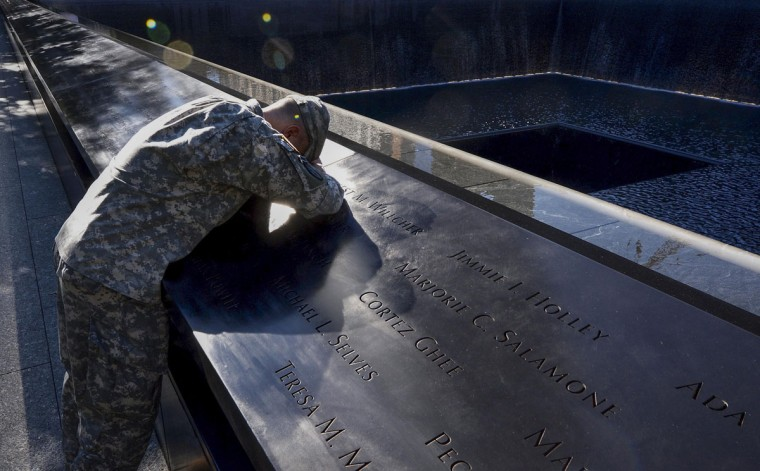 Scott Willens, who joined the United States Army three days after the attacks on 9/11, pauses while reflecting by the South Pool on friends he has lost while on deployment during ceremonies marking the 11th anniversary of the 9/11 attacks on the World Trade Center in New York, September 11, 2012. (Justin Lane/Reuters)