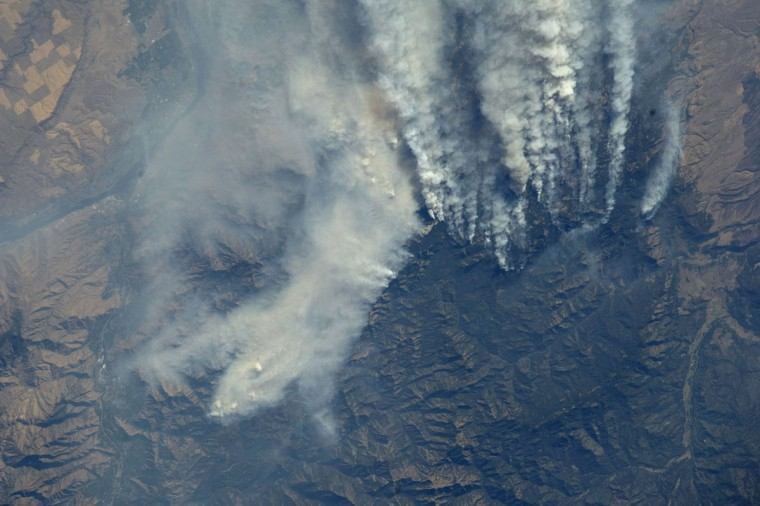 The Mustang Complex wildfires in Idaho are seen from the International Space Station at an altitude of approximately 260 miles above earth in this NASA handout photo taken by a crew member from Expedition 33, September 19, 2012. The Mustang Complex fire has devoured at least 280,000 acres of pine forests since it grew from several separate lightning-sparked blazes in late July in remote stretches of the Salmon-Challis National Forest. (NASA/handout/Reuters)