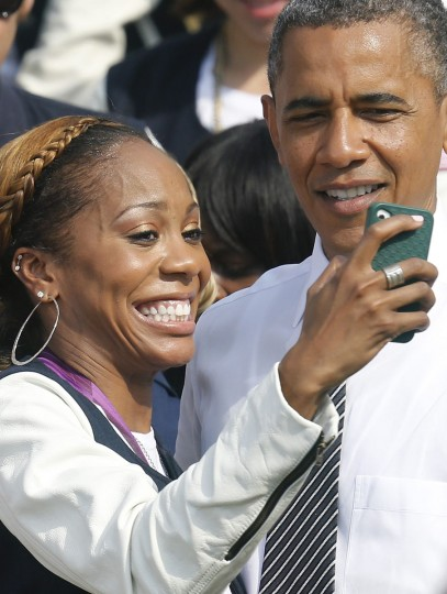 U.S. Olympic 400m sprint gold medalist Sanya Richards-Ross takes a picture with U.S. President Barack Obama during a visit to the White House. (Jonathan Ernst/Reuters)