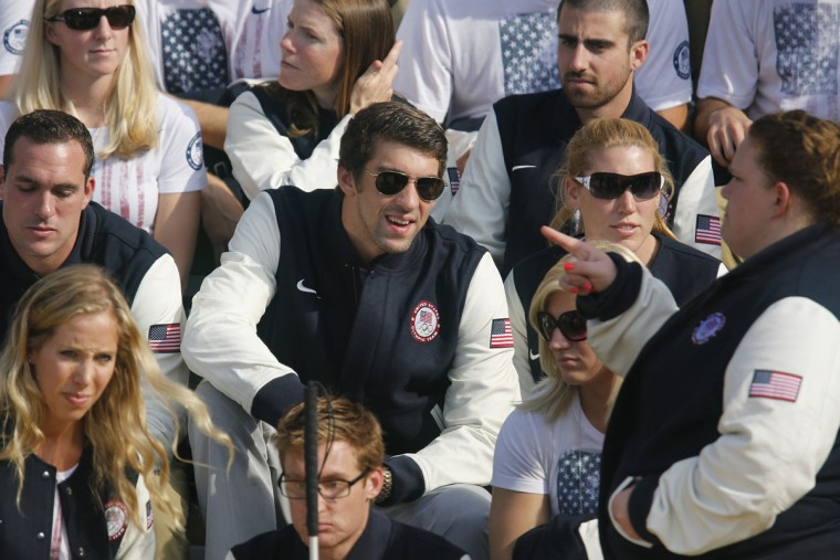 U.S. Olympic swimmer Michael Phelps sits with fellow athletes during President Barack Obama's reception for members of the 2012 U.S. Olympic and Paralympic teams at the White House. (Jonathan Ernst/Reuters)