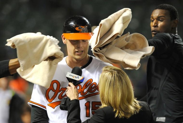 June 17, 2009: Orioles catcher Matt Wieters gets a shaving cream pie in the face from teammate Adam Jones, at right. (Lloyd Fox/Baltimore Sun Photo)