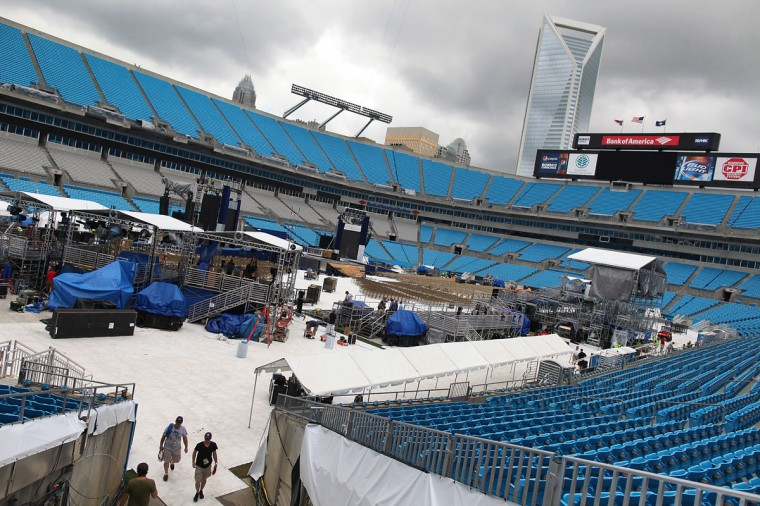 Workers dismantle the stage which was set for the final night of the Democratic National Convention 2012 at Bank of America Stadium in Charlotte. Weather forecast for the area forced a move to the Time Warner Cable Arena.(Brian van der Brug/Los Angeles Times)