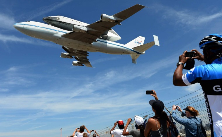 People stand along Aviation Blvd. as the space shuttle Endeavour passes by at LAX Friday. (Wally Skalij/Los Angeles Times)