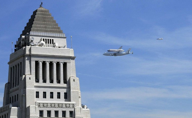The space shuttle Endeavour flies over city hall in Los Angeles during flyovers of southland landmarks. (Marc Martin/Los Angeles Times)
