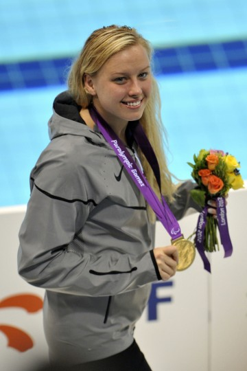 Jessica Long (USA) is seen with her gold medal after the women's 100m breaststroke-SB7 medal ceremony during the London 2012 Paralympic Games at Aquatics Centre. (Andrew Fielding/US PRESSWIRE)
