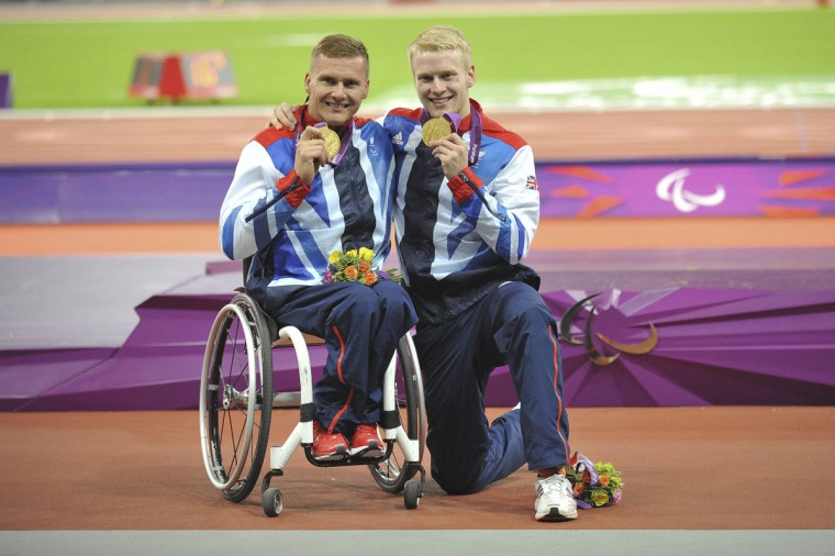 David Weir (GBR), left, and Jonnie Peacock (GBR) pose for a photo after receiving their gold medals during the London 2012 Paralympic Games at Olympic Stadium on September 6, 2012. (Andrew Fielding/US Presswire)