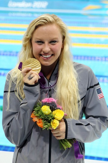 Jessica Long (USA) collects her gold medal for the women's 100m freestyle S8 final during the London 2012 Paralympic Games at Aquatics Centre on September 6, 2012. (Paul Cunningham/US Presswire)