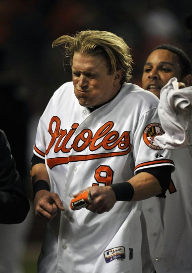 Sept. 12, 2012: Orioles left fielder Nate McLouth braces himself as teammate Robert Andino pelts him with a shaving cream pie. (Joy R. Absalon/US Presswire)