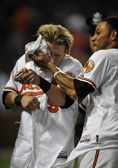 Sept. 12, 2012: Orioles left fielder Nate McLouth gets hit with a shaving cream pie by teammate Robert Andino. McLouth hit a walk-off single against the Tampa Bay Rays on Sept. 12 at Camden Yards. (Joy R. Absalon/US Presswire)