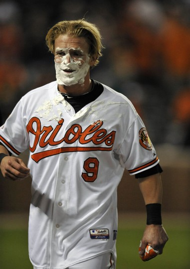 Sept. 12, 2012: Orioles left fielder Nate McLouth reacts to getting a shaving cream pie in the face for hitting a game-winning walk-off single against the Tampa Bay Rays. (Joy R. Absalon/US Presswire)