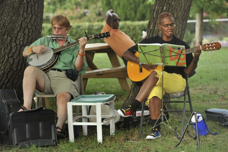 """Music at the Druid Hill Farmers Market changes weekly. Will Blair, left, and Khalilah Ali, right, of """"Blair Live Acoustics"""" provided the live music this afternoon. (Amy Davis/Baltimore Sun)"""