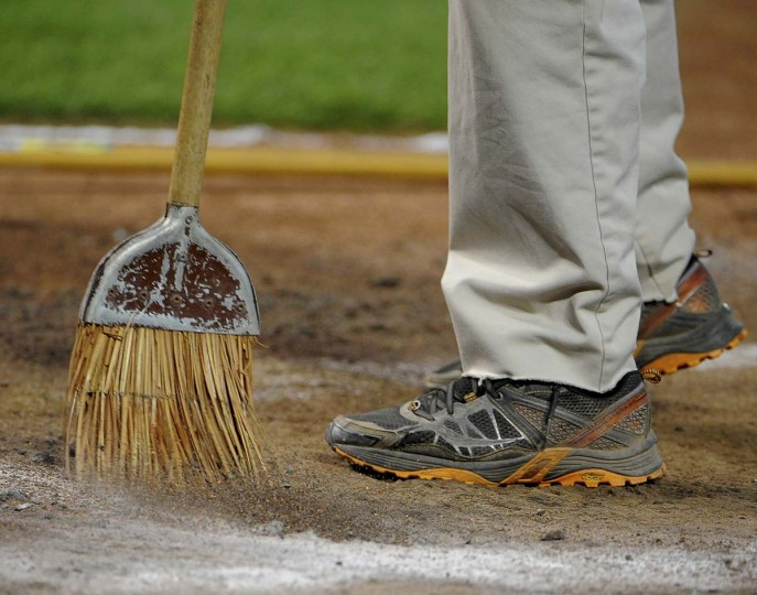 The area around home plate at Camden Yards is being swept in preparation for the raking and chalking of the lines. (Gene Sweeney Jr. /Baltimore Sun)