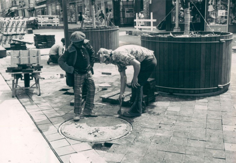 May 20, 1975 - A worker and his youthful supervisor work to complete the pedestrian mall. (Baltimore Sun archives)