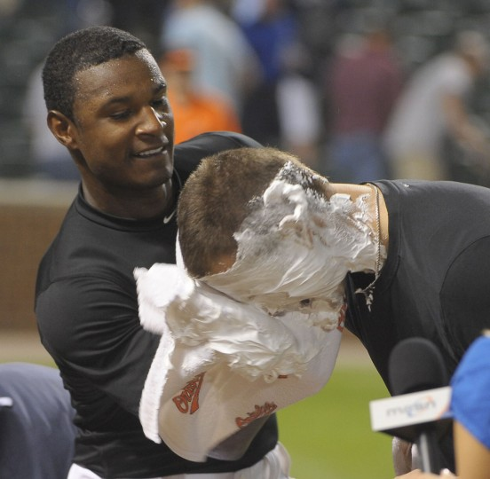 "June 10, 2010: Adam Jones gives a ""shaving cream pie"" to pitcher Jake Arrieta after Arrieta was credited with a win in his debut Major League game. (Gene Sweeney Jr./Baltimore Sun Photo)"
