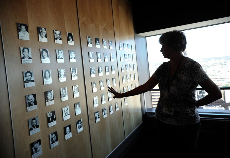 Baltimore, MD-9/10/12-Amy Carrick, operations supervisor of Top of the World, stands by the 9/11 memorial exhibit on the top floor of the World Trade Center. The photographs are of all Marylanders killed in the 9/11 attacks. (Algerina Perna/Baltimore Sun)