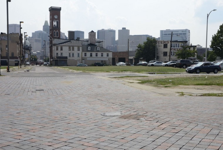 """August 9, 2012 - This grassy field was once dubbed """"the field of dreams"""" because of development potential. In recent winters, the city has used the space to dump snow. (Olivia Hubert-Allen/Baltimore Sun photo)"""