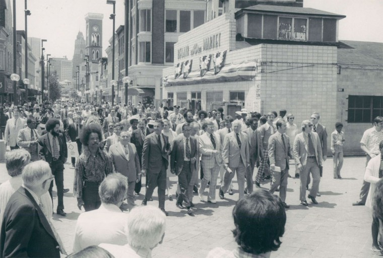 June 5, 1976 - Crowds of officials tour the mall during a dedication ceremony. In the background is the Belair Market, one of the city's oldest markets. The final parts of the market were torn down in 2002. (Baltimore Sun archives)