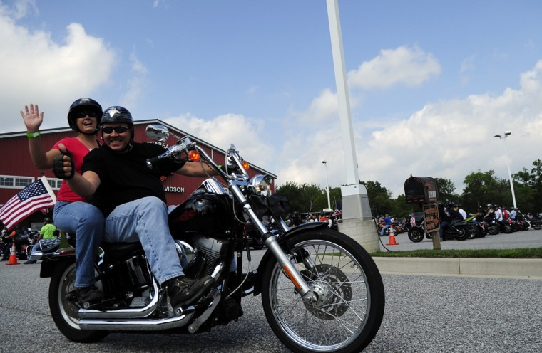 Proud riders wave for the camera as they set out on a beautiful Saturday morning from Chesapeake Harley-Davidson for the Patriot Day Ride. (Matt Button/Aegis Staff)