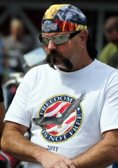 Norman Meadows of Bel Air shares in one of the moments of silence and prayer before joining the many other riders in Saturday's Patriot Day Ride starting at Chesapeake Harley-Davidson. (Matt Button/Aegis Staff)