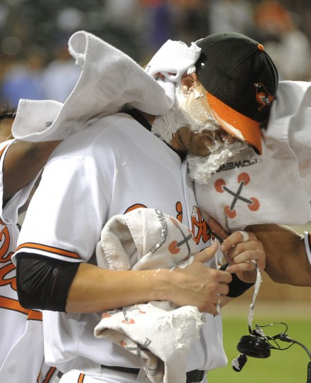 "August 2011: Nolan Reimold gets the ""shaving cream pie"" after the game for his game winning, 2 run home run in the 10th inning. (Gene Sweeney Jr., Baltimore Sun)"