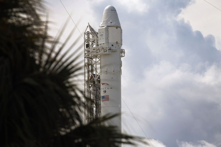 October 7, 2012: A SpaceX Falcon 9 rocket attached to the cargo-only capsule called Dragon sits on the lauch pad for a scheduled evening launch in Cape Canaveral, Florida. (Joe Raedle/Getty Images)