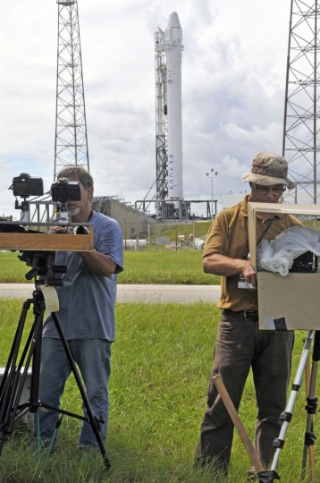 October 7, 2012: Photographers set up remote cameras as SpaceX's Falcon 9 rocket with the Dragon space craft are readied for an evening launch from Cape Canaveral, Florida, to the International Space Station. (Bruce Weaver/AFP/Getty Image)