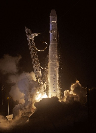 October 7, 2012: SpaceX's Falcon 9 rocket blasts off launching the cargo-laden Dragon capsule into orbit en route to the International Space Station for NASA's first privately-run supply mission. (Bruce Weaver/AFP/Getty Images)