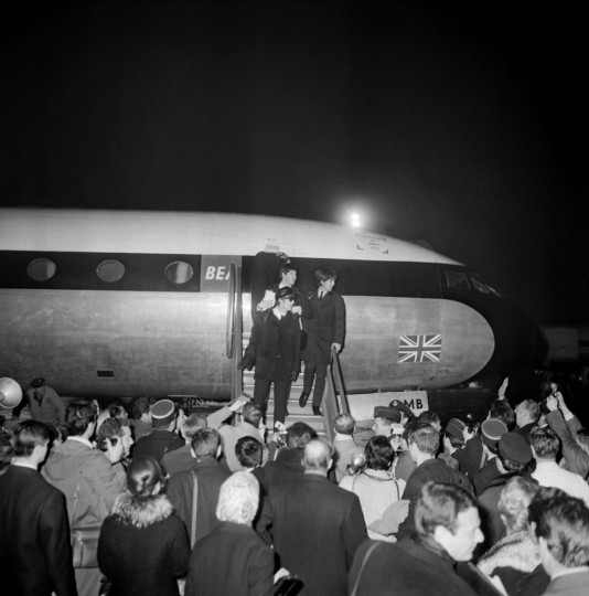 The Beatles arrive 15 January 1964 in France at the Bourget airport near Paris, to perform their first series of concerts outside of Britain. (Getty Images)