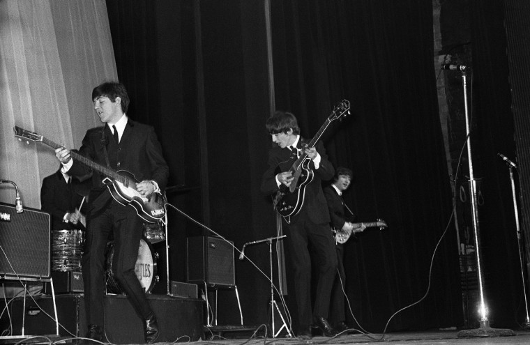 The Beatles perform 17 January 1964 their first concert outside of Britain, at the Olympia in Paris. (Getty Images)