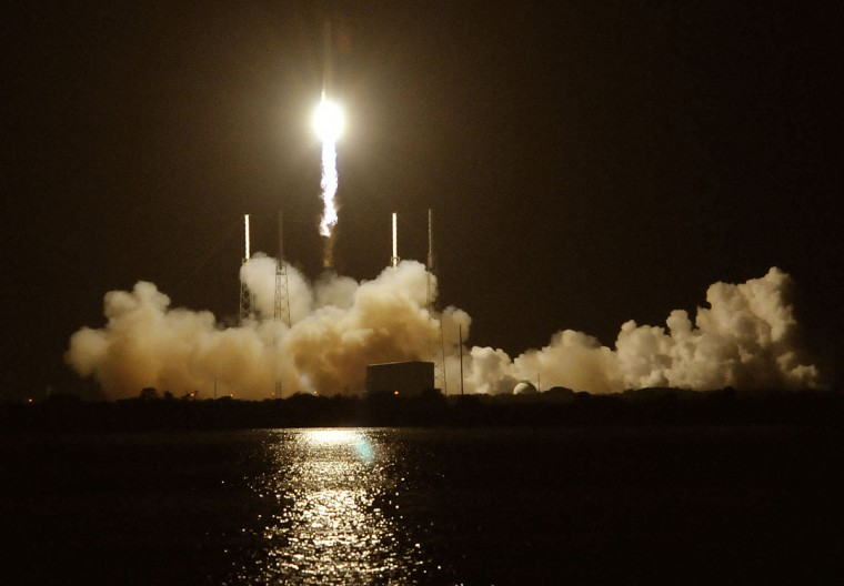 October 7, 2012: SpaceX's Falcon 9 rocket blasts off carrying the company's Dragon CRX-1 spacecraft from Pad 40 at Cape Canaveral, Florida. (Bruce Weaver/AFP/Getty Images)