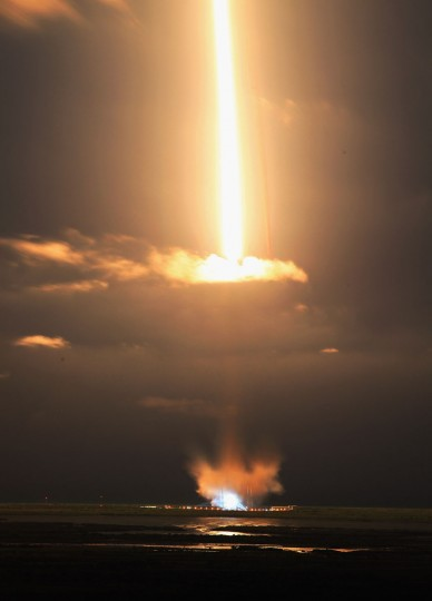 October 7, 2012: A 30 second camera exposure shows SpaceX Falcon 9 rocket attached to the cargo-only capsule called Dragon as it lifts off from the launch pad in Cape Canaveral, Florida. (Joe Raedle/Getty Images)