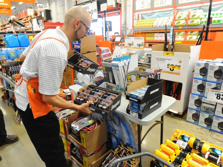 Paint Department supervisor Fred Jogerit puts out more batteries on at the Home Depot store on Eastern Avenue as city and county residents buy up emergency supplies such as flash lights, batteries and gas generators to prepare for the weekend arrival of Hurricane Sandy. (Kenneth K. Lam/The Baltimore)