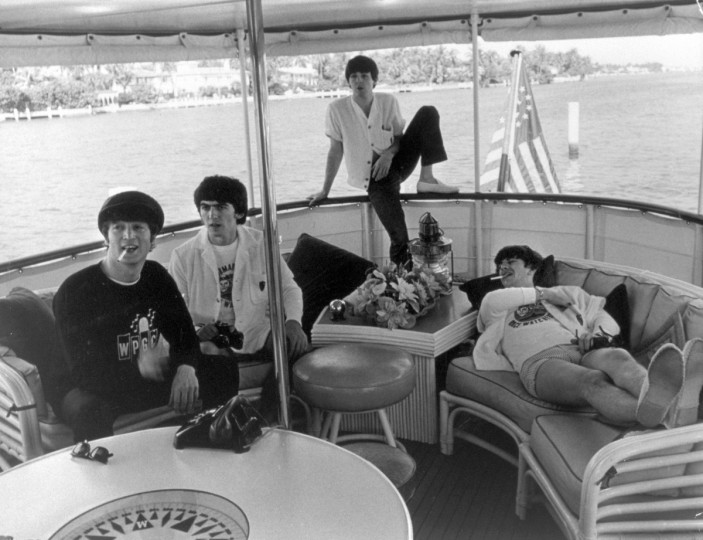 British rock group The Beatles relax on a boat off the coast of Miami, Florida, February 1964. L-R: John Lennon, George Harrison, Paul McCartney and Ringo Starr. (Express Newspapers/Getty Images)