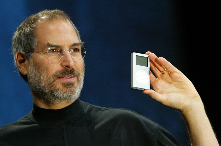 January 6, 2004: Apple CEO Steve Jobs holds a new mini iPod at Macworld in San Francisco. Jobs announced several new products including the new iLife 4 software and the Mini iPod. (Photo by Justin Sullivan/Getty Images)