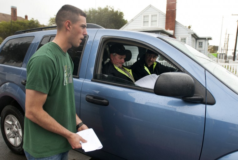 Ocean City resident James Wells talks with Senior Trooper Kevin Rhodes and Corporal John Bowman of the Maryland State Police about the evacuation plans in town Sunday afternoon. The Troopers were going door to door advising residents of the evacuation. (Grant L. Gursky/Daily Times)