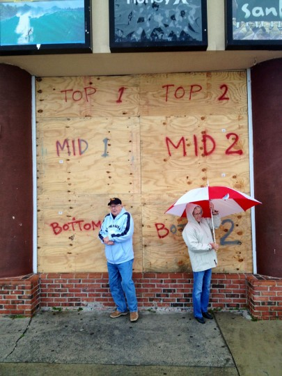 Richard Soistman and wife Sandy of Ocean Pines looks out from shelter in front of the boarded store Quietstorm as the hurricane bearing her name makes an initial impact. (Karl Merton Ferron/Baltimore Sun)