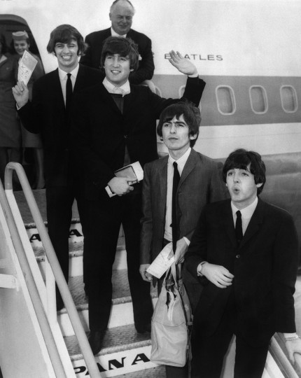 "18 August 1964 - British pop music group ""Beatles"" leave the London airport for a tour in United-States. (Getty Images)"
