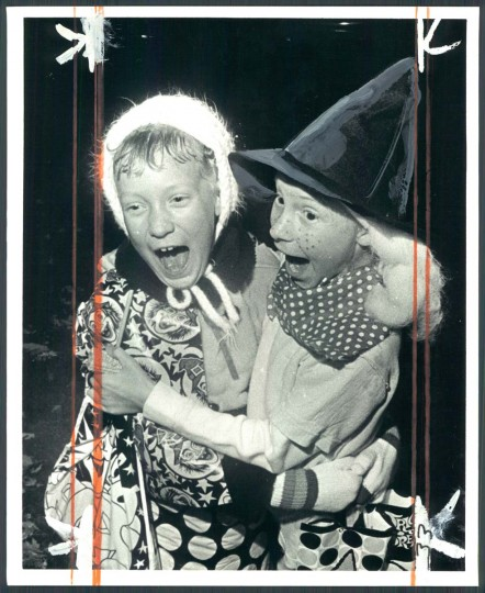 Two kids react to a Halloween display. Oct. 31, 1973. (Richard Childress/Baltimore Sun)