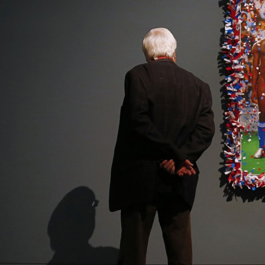 A man looks at an artwork by French artist duo Pierre et Gilles (Pierre Commoy and Gilles Blanchard) entitled 'Vive la France (Long Live France),' as part of the 'Nackte Maenner' (Nude Men) exhibition at the Leopold Museum in Vienna, on October 18, 2012. (Alexander Klein/AFP/Getty Images, cropping by The Baltimore Sun)