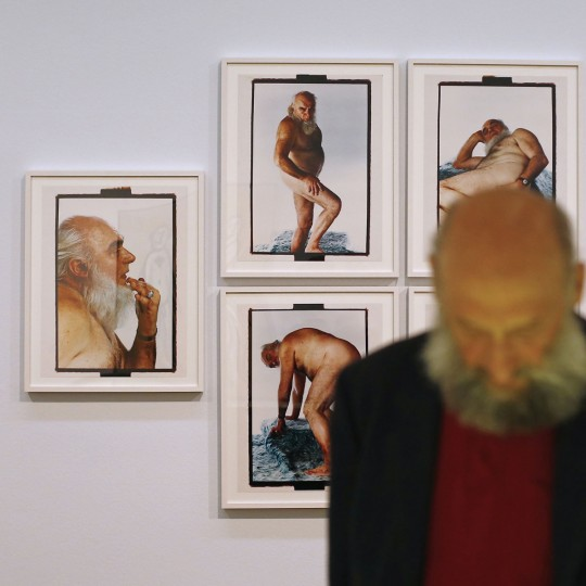 A man with a beard passes by an artwork by Croatian artist Tomislav Gotovac, entitled 'Foxy Mister,' as part of the 'Nackte Maenner' (Nude Men) exhibition at the Leopold Museum in Vienna, on October 18, 2012. (Alexander Klein/AFP/Getty Images, cropping by The Baltimore Sun)